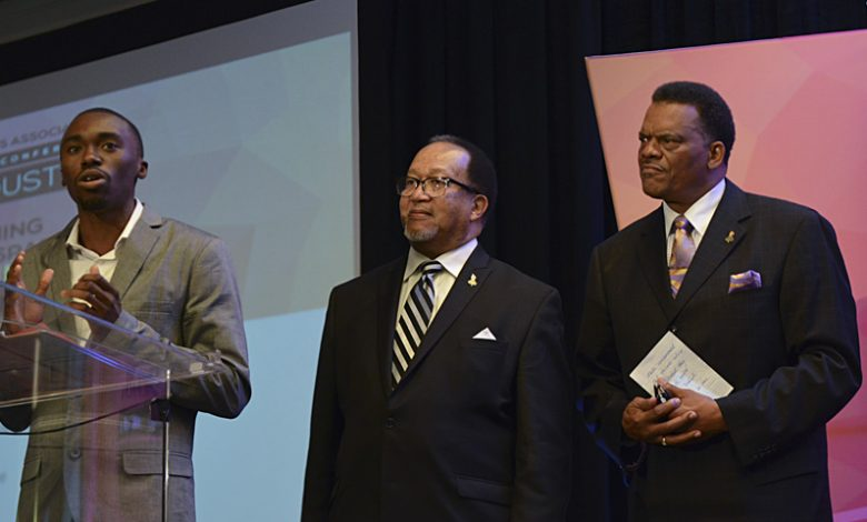 Roosevelt McClary (left), secretary of the Broward Teachers Union, speaks as NNPA President and CEO Benjamin F. Chavis Jr. (center) and Westside Gazette publisher Bobby Henry look on during the ESSA/NNPA student workshop at the 2017 NNPA Mid-Winter Conference in Fort Lauderdale, Fla. (Freddie Allen/AMG/NNPA)