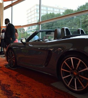 Porsche Inc., a sponsor for the event, puts a car on display in the lobby as part of the Icon Talks Empowerment Tour on Thursday, June 30 at the Arena Stage Mead Center for American Theater in Southwest. /Photo by Patricia Little