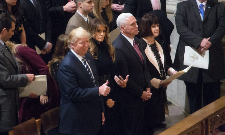President Donald Trump and wife Melania attend the National Prayer Service at the Washington National Cathedral on Jan. 21. (Mark Mahoney)
