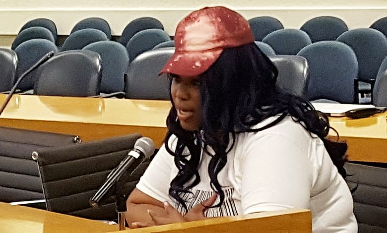 Chauniece Jones of Largo, Maryland, testifies at an Oct. 20 public hearing on Metro's proposal to permanently cut hours of operation at its train stations. /Photo by William J. Ford