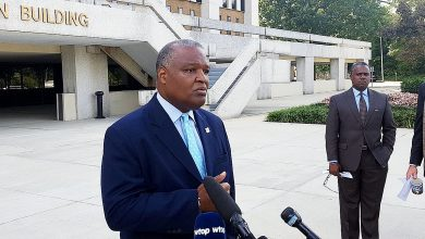 Prince George's County Executive Rushern L. Baker III speaks to reporters outside the county administration building on Oct. 12 regarding public schools CEO Kevin Maxwell, who is under siege from the NAACP amid several recent scandals. /Photo by William J. Ford