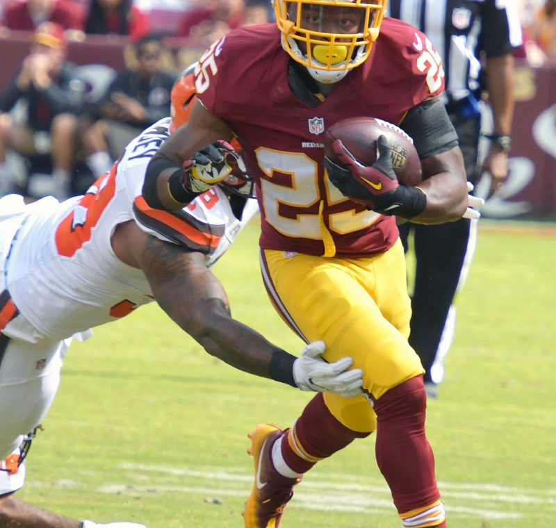 Washington Redskins running back Chris Thompson evades Cleveland Browns defensive back Briean Boddy-Calhoun for a first down during the Redskins' 31-20 win at FedEx Field in Landover, Maryland, on Sunday, Oct. 2. /Photo by John E. De Freitas