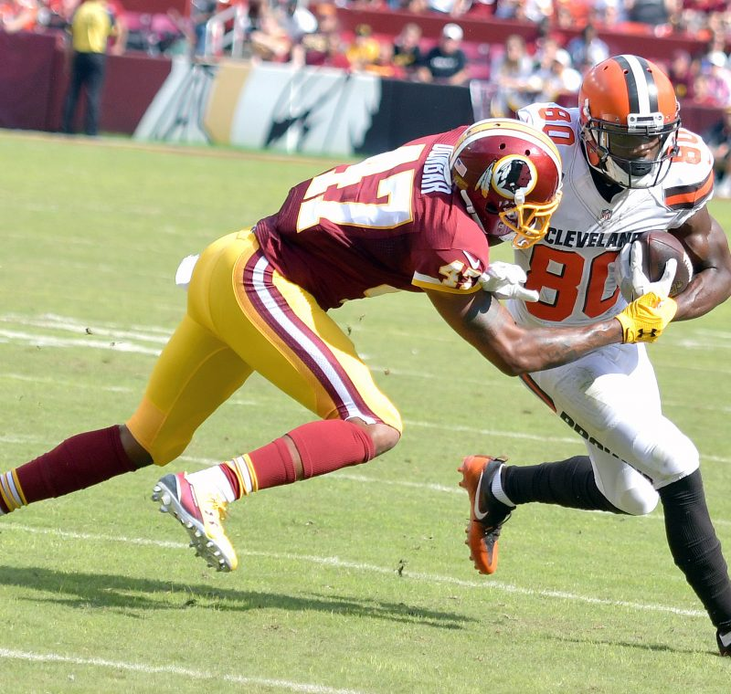 Washington Redskins cornerback Quinton Dunbar tackles Cleveland Browns wide receiver Ricardo Louis during the Redskins' 31-20 win at FedEx Field in Landover, Maryland, on Sunday, Oct. 2. /Photo by John E. De Freitas