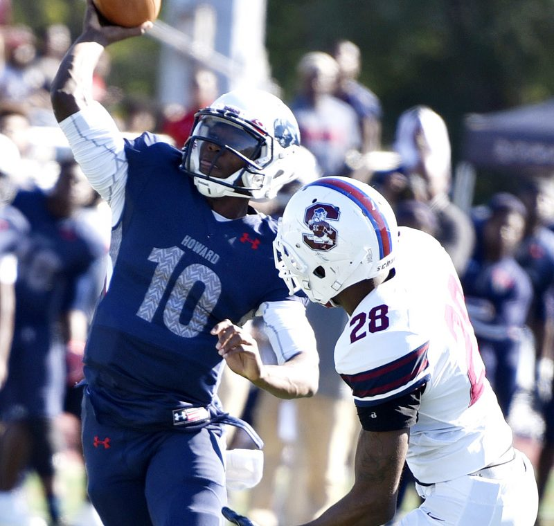 Howard quarterback Jason Collins evades South Carolina State linebacker Johnell Brown to attempt a pass during South Carolina State's 14-9 win at William H. Greene Stadium in northwest D.C. on Saturday, Oct. 15. /Photo by John E. De Freitas