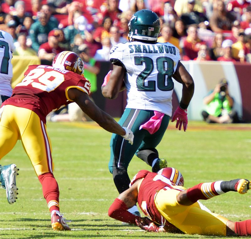 Philadelphia Eagles running back Wendell Smallwood dodges Washington Redskins tacklers en route to a 86-yard kickoff return for a touchdown during the Redskins' 27-20 win at FedEx Field in Landover, Maryland, on Sunday, Oct. 16. /Photo by John E. De Freitas