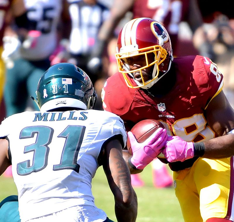 Washington Redskins wide receiver Pierre Garcon braces for a hit from Philadelphia Eagles cornerback Jalen Mills during the Redskins' 27-20 win at FedEx Field in Landover, Maryland, on Sunday, Oct. 16. /Photo by John E. De Freitas