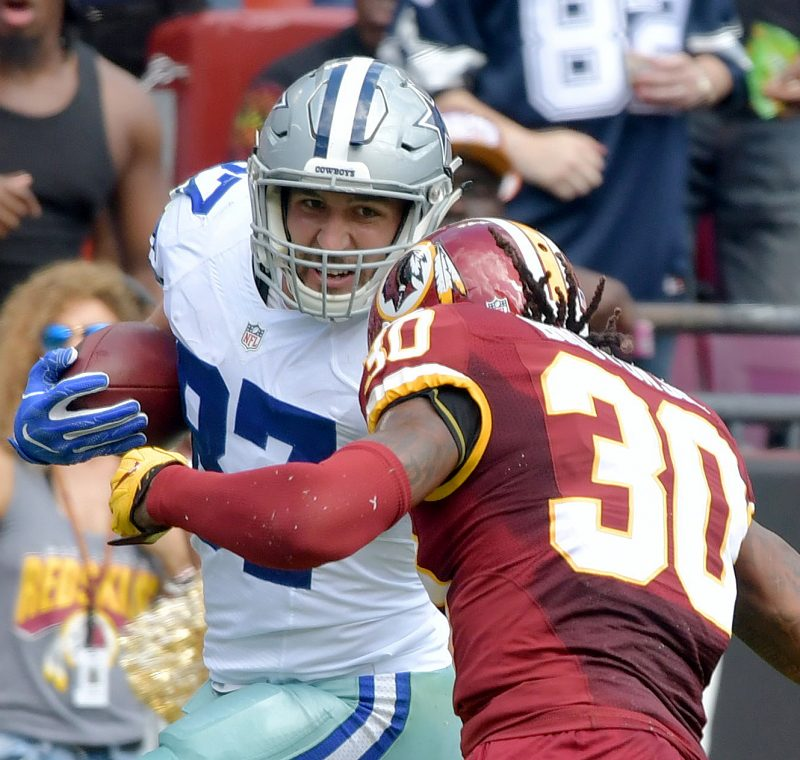 Dallas Cowboys tight end Geoff Swaim is tackled by Washington Redskins safety David Bruton Jr. during the Cowboys' 27-23 win at FedEx Field in Landover, Maryland, on Sunday, Sept. 18. /Photo by John E. De Freitas