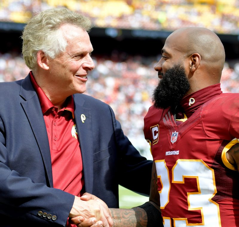 Virginia Gov. Terry McAuliffe chats with Washington Redskins safety DeAngelo Hall during halftime of the Dallas Cowboys' 27-23 win over Washington at FedEx Field in Landover, Maryland, on Sunday, Sept. 18. /Photo by John E. De Freitas