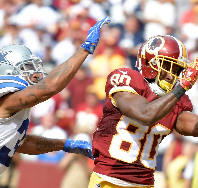 Washington Redskins wide receiver Jamison Crowder beats Dallas Cowboys cornerback Orlando Scandrick to make a third-quarter touchdown reception during the Cowboys' 27-23 win at FedEx Field in Landover, Maryland, on Sunday, Sept. 18. /Photo by John E. De Freitas
