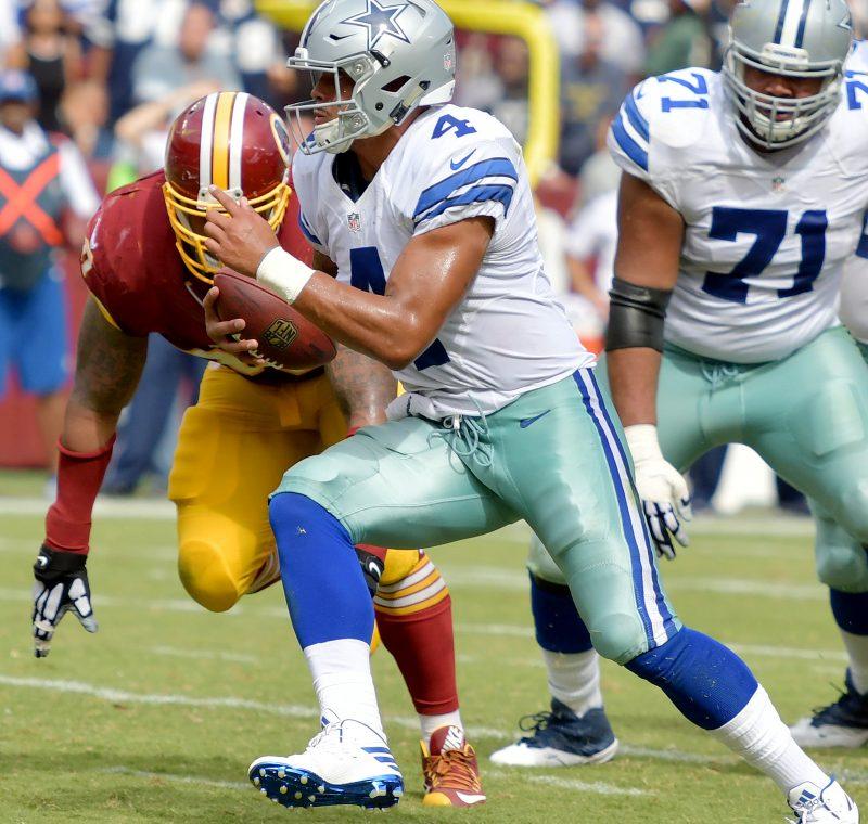 Dallas Cowboys quarterback Dak Prescott runs for a third-quarter touchdown during the Cowboys' 27-23 win over the Washington Redskins at FedEx Field in Landover, Maryland, on Sunday, Sept. 18. /Photo by John E. De Freitas