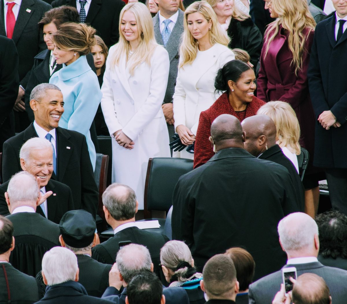 President Obama and FLOTUS Michelle Obama smiling before taking their seats at the inauguration ceremony for the 45th President. /Photo by Shevry Lassiter
