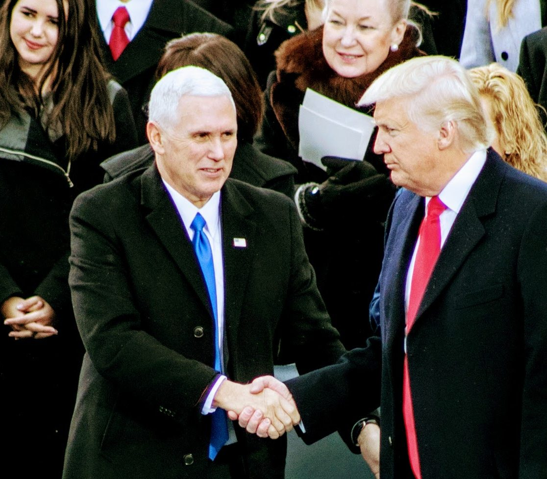 The 45th President of the United States and his Vice President shake hands after receiving their Oaths of Office during inauguration ceremony held at the Capitol on January 20, 2017. /Photo by Shevry Lassiter