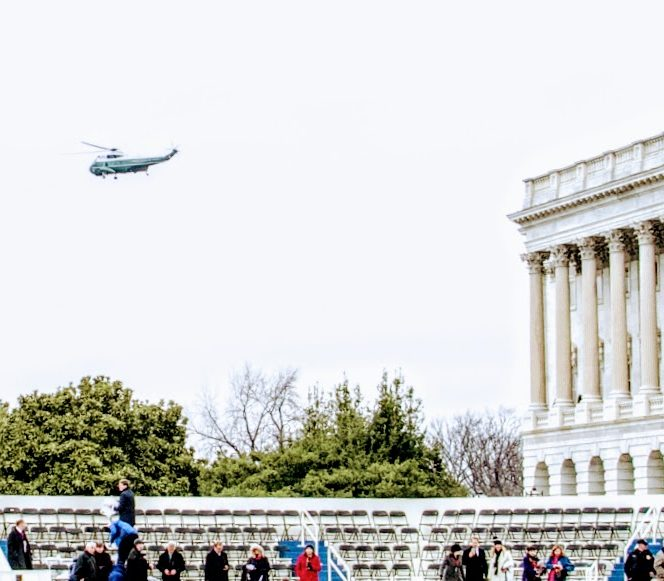 Former President Barack Obama leaves the ceremony on a helicopter. /Photo by Shevry Lassiter