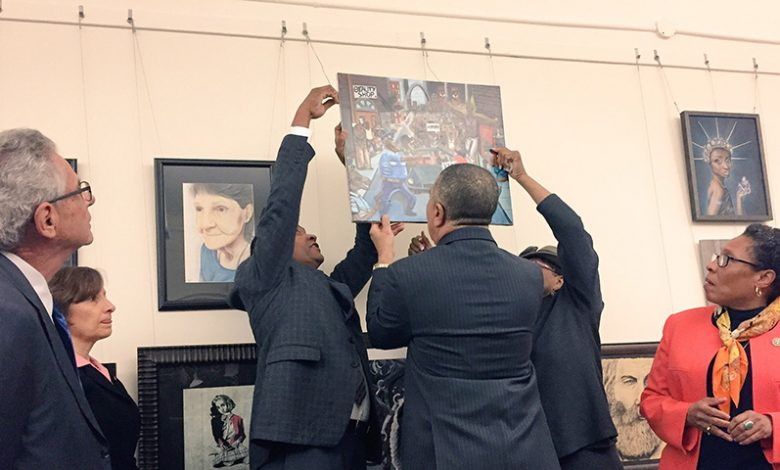 CBC members hang student's artwork on January 10, after a Republican congressman removed it early last week. (Lauren Burke/NNPA)