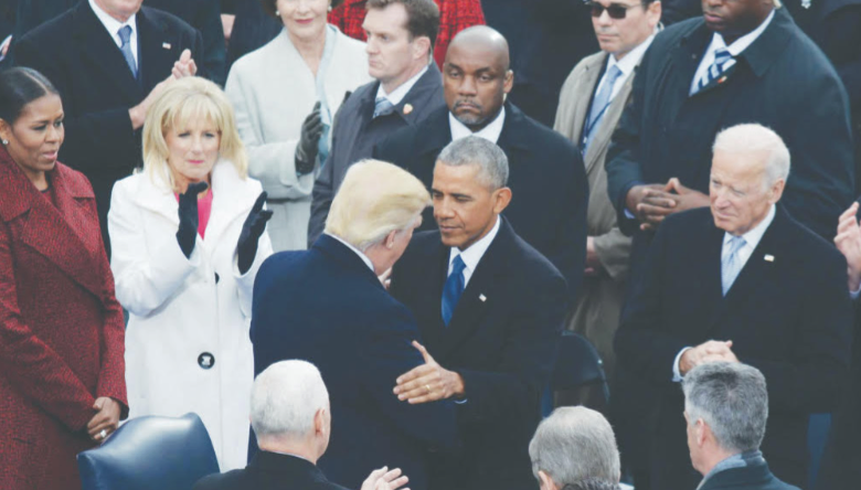 The 44th President Barack Obama and the 45th President Donald Trump greet each other at the 58th Presidential Inauguration on Friday, Jan. 20 at the U.S. Capitol. (Roy Lewis/The Washington Informer)