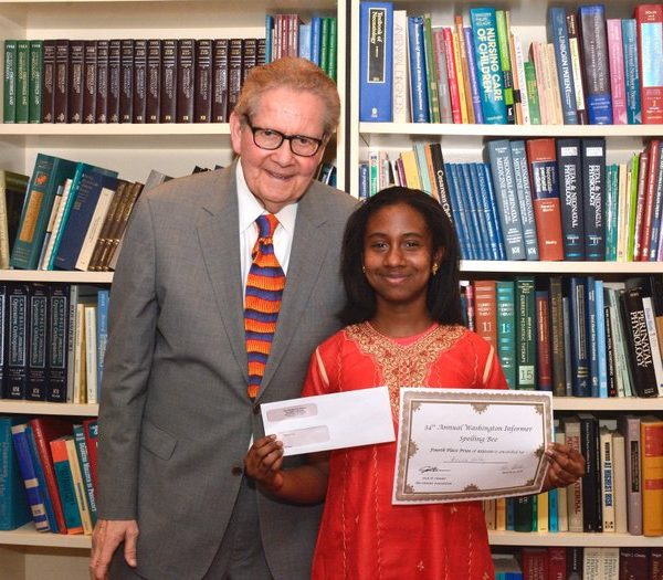 Attorney Jack Olender presents Fourth place winner of the 34th Annual Washington Informer Spelling Bee, Anina Holley with the 4th place prize of $250 and a certificate Thursday, April 14.