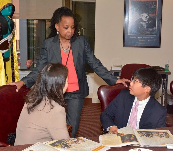 Publisher of The Washington Informer Denise Rolark Barnes chats with First place winner of the 34th Annual Washington Informer Spelling Bee William Cho and his mother Thursday, April 14.