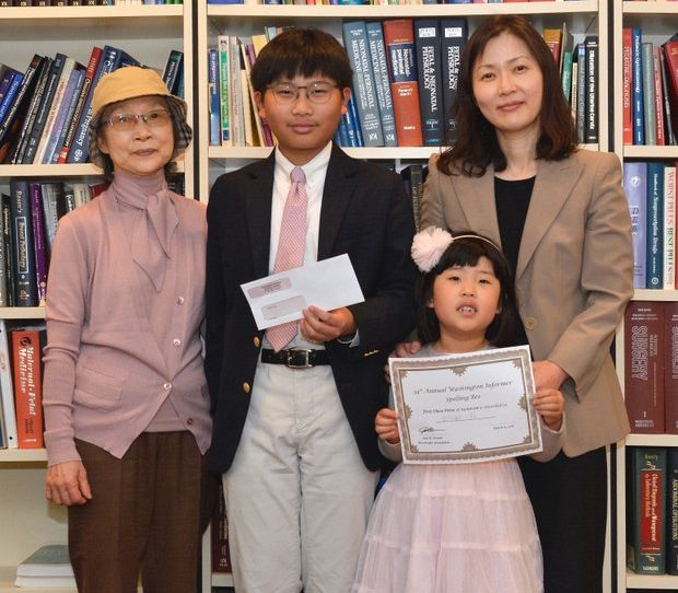 First place winner of the 34th Annual Washington Informer Spelling Bee, William Cho and his family poses for a photo in the office of Attorney Jack Olender upon receiving his cash award and certificate April 14.
