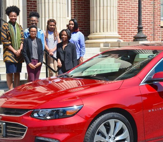 (From L to R, front row first) Fellow students of the new Chevrolet and NNPA Journalism Fellowship Program opts in for a group photo with their new Chevrolet Malibu Friday, April 15. Photo by Travis Riddick. Victoria Jones, Tatyana Hopkins, Sidney King, Mckenzie Marshall, Brelaun Douglas, Briahnna Brown.