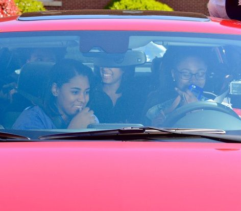 The excited fellow students sits inside their brand new Chevrolet Malibu to check out all it's, impressive features and comfort ability Friday, April 15.