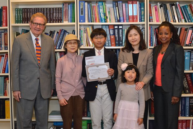 William Cho (center) poses for a group photo with his family, Attorney Jack Olender and publisher of The Washington Informer Denise Rolark Barnes Thursday, April 14.