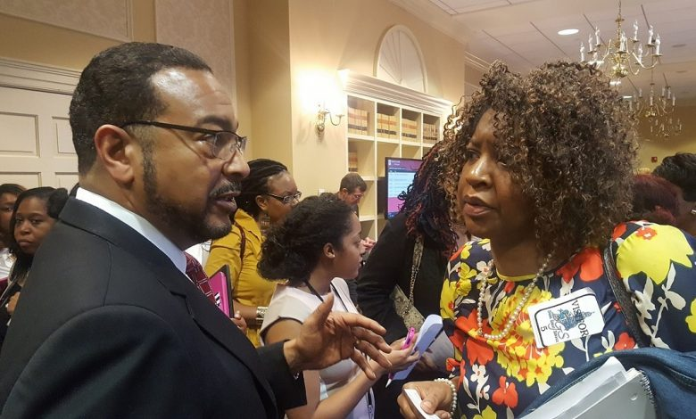 Maryland state Sen. C. Anthony Muse (left) chats with Sophie Ford, executive director of the Family Crisis Center of Prince George's County, after she and others testified at a Feb. 23 hearing before the Senate's Judicial Proceedings Committee about a bill addressing domestic violence. (William J. Ford/The Washington Informer)