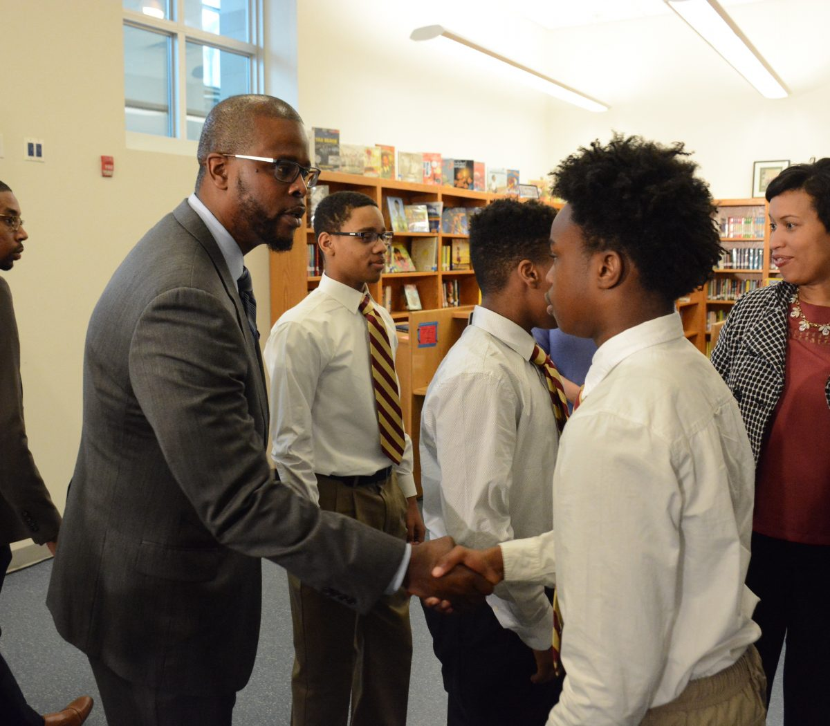 DCPS Chancellor Antwan Wilson greets students at the Emerging Men of Color program at Alice Deal Middle School in Northwest on February 1, 2017. /Photo by Roy Lewis