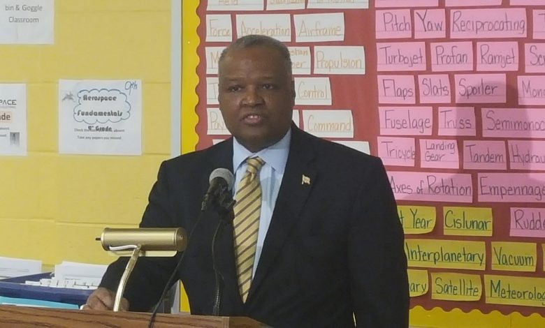 Prince George's County Executive Rushern L. Baker III announces the reappointment of schools CEO Kevin Maxwell during a press conference at DuVal High School in Lanham on Feb. 17. (William J. Ford/The Washington Informer)