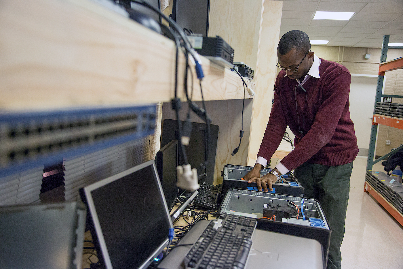 Ward 8 resident learns the art of computer refurbishing. (Courtesy photo)