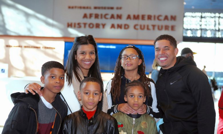 Erin Martin, interim program director of the Boys and Girls Club's FBR branch, poses with club members at the African American History Museum while on the 2017 Washington Informer Heritage Tour. (Demetrious Kinney)