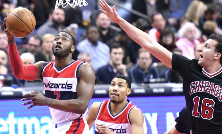 Washington Wizards guard John Wall drives to the basket beyond the outstretched arm of Chicago Bulls forward Paul Zipser in the third quarter of the Wizards' 112-107 win at Verizon Center in D.C. on March 17. (John De Freitas/The Washington Informer)