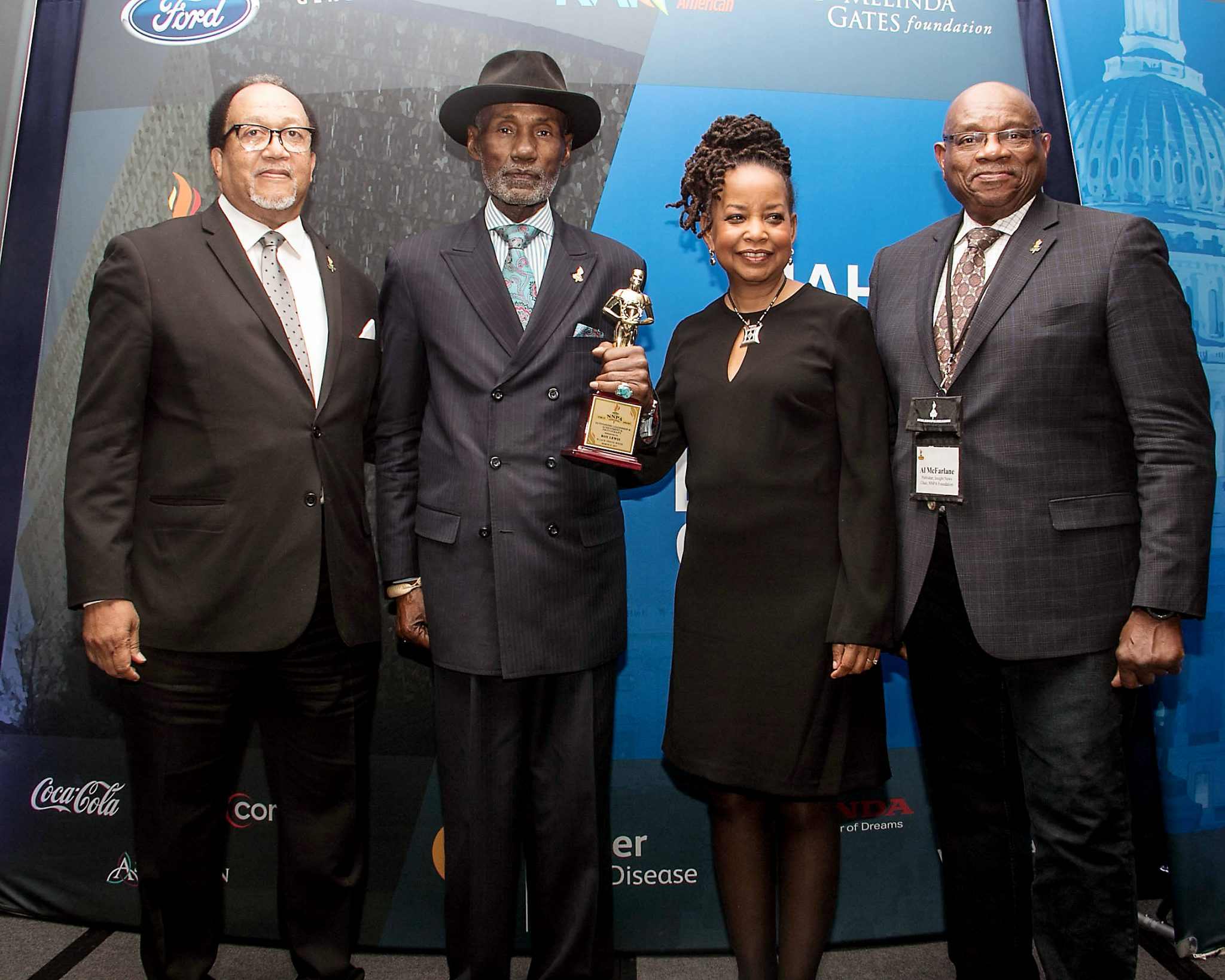 Officers for the National Newspaper Publishers Association present Roy Lewis (second from left) with a Torch Award for his outstanding achievement during Black Press Week at the Dupont Circle Hotel in northwest D.C. on March 23. (Shevry Lassiter/The Washington Informer)