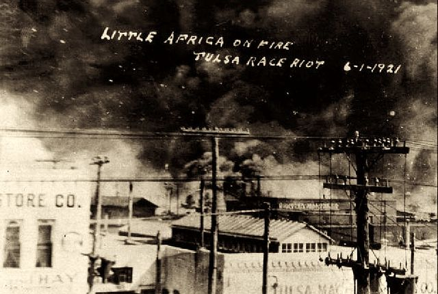 In this postcard from the collection of McFarlin Library at the University of Tulsa, a photo from on top of the Santa Fe Freight office at 1st Street and Elgin Avenue in Tulsa, Oklahoma, is seen, showing the fires on Archer towards Greenwood. The Goodner-Malone company (1 N. Frankfurt) building is in the center of the photo. (Courtesy of Wikimedia Commons)