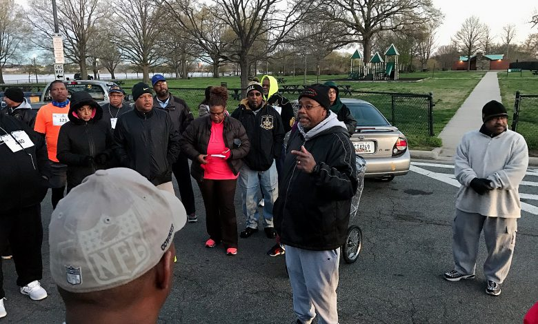 Stephen Jefferson talks to participants in a 5K walk for cancer awareness at West Potomac Park in northwest D.C. on April 8. (Hamil R. Harris/The Washington Informer)