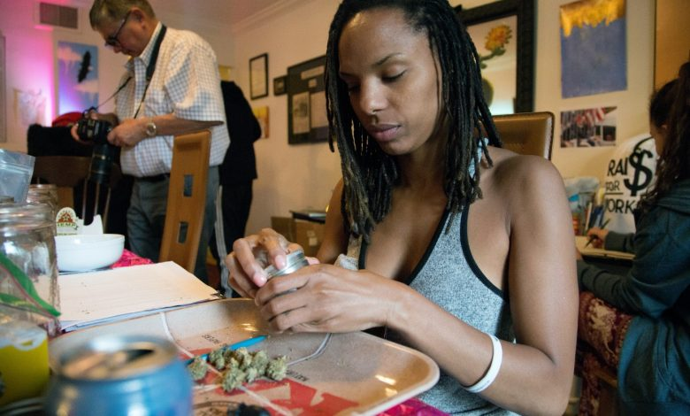 Marijuana advocate and volunteer Felicia Simpson rolls marijuana joins for the 1st Annual Congressional #JointSession in preparation for the cannabis giveaway on Capitol Hill to bring attention to the federal law restrictions that impede on local enforcement of marijuana policies. (Mark Mahoney/The Washington Informer)