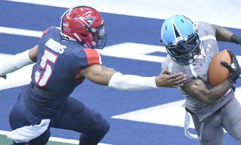 Philadelphia Soul wide receiver Chris Duvalt evades Washington Valor Bernard Morris during Philadelphia's 49-31 win at Verizon Center in Northwest on April 22. (John E. De Freitas/The Washington Informer)