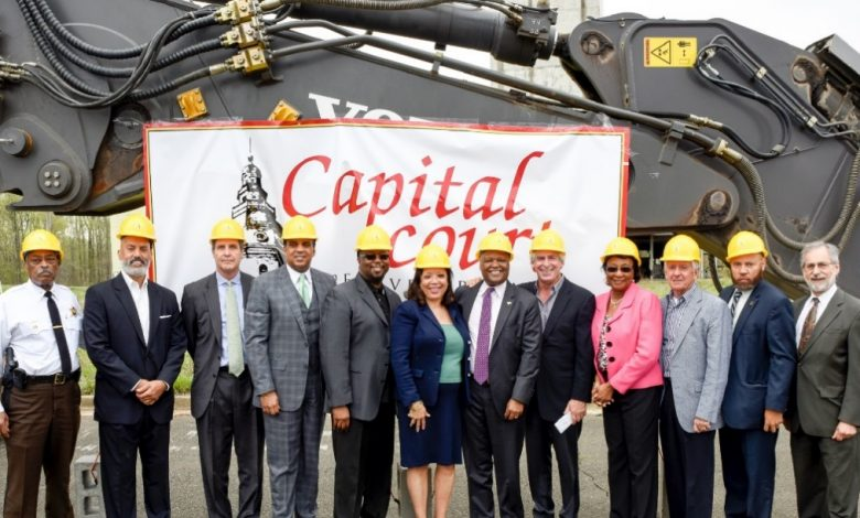 Prince George's County Executive Rushern Baker (7th from left) and numerous county dignitaries and well-wishers take part in a groundbreaking ceremony for the Capital Court redevelopment project at the former site of the Metropolitan Baptist Church in Largo. (Courtesy of PGCEDC)