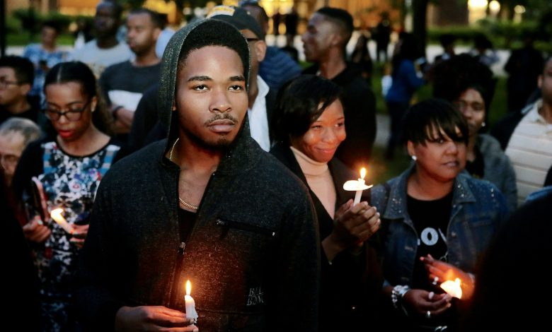 Hundreds of students, alumni and other supporters attend a candlelight vigil May 22 to honor Richard Collins III, who would have graduated from the school May 23. (Demetrious Kinney/The Washington Informer)