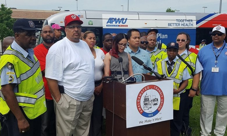 Tracy Smith (at podium), a shop steward and executive board member with Amalgamated Transit Union Local 689, discusses lack of safety on Metro buses during a May 18 press conference outside the Shepherd Parkway Metrobus Division in southwest D.C. (William J. Ford/The Washington Informer)