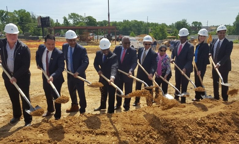 Prince George's County Executive Rushern L. Baker III (fifth from left), site owner Mani Patel (fourth from left) and others dig dirt as part of groundbreaking ceremony for a $50 million retail development in Brandywine on May 10. (William J. Ford/The Washington Informer)