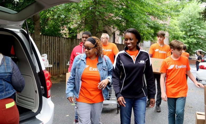 Linda (left), a resident of Bel Air, Maryland, and Rhea Marshall (right) of Upper Marlboro volunteer with Exelon and We Are Family to deliver food to elderly residents in northwest D.C. on May 20. (Shevry Lassiter/The Washington Informer)