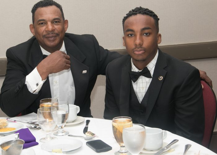 Andre McGant, class of '76 and his son Jordan Roberts-McGant, a 9th grader at Wheaton High School are inducted into the 2017 Cardozo All-Met Hall of Fame during the 8th Annual Awards Dinner in Upper Marlboro, Md., April 30, 2017. /Photo by Shevry Lassiter
