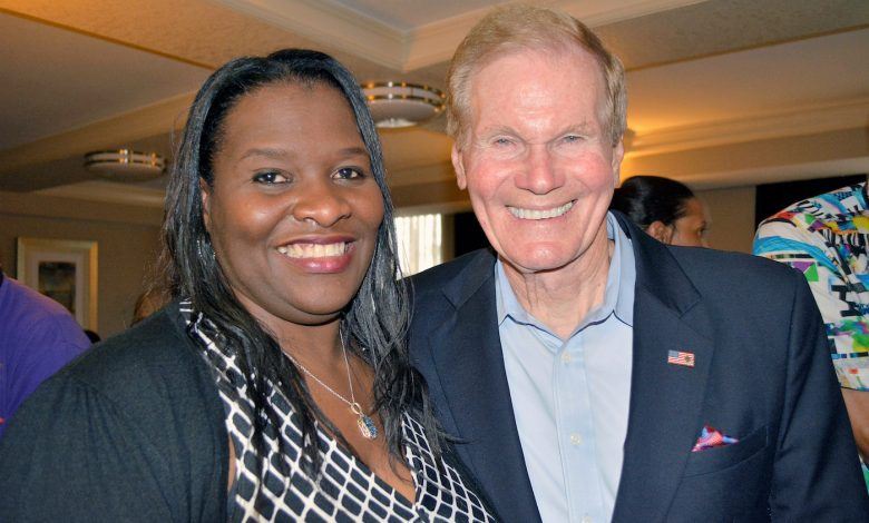 Lydia Hudson (left), the newly elected president of the Democratic Black Caucus of Florida, chats with Florida Sen. Bill Nelson during the organization's 35th annual conference in Orlando on May 18 about the upcoming 2018 midterm elections and the need for more blacks to register and then vote. (Louis Ward)