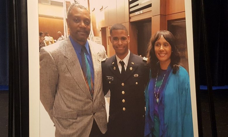 A photo of slain Bowie State University student Richard Collins III (center) with his parents is displayed at a vigil at the university on May 22.