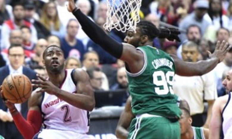 Washington Wizards guard John Wall drives to the basket against Boston Celtics forward Jae Crowder in the third quarter of the Wizards' 92-91 victory in Game 6 of the Eastern Conference semifinals at Verizon Center in D.C. on May 12. (John De Freitas/The Washington Informer)
