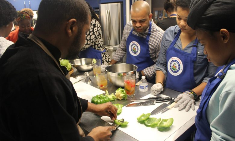 Chef Dimitri Lilavois instructs participants in cooking techniques. (Imani Cezanne/Busboys and Poets)