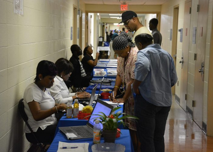 """Community leaders from Ward 8 sign up to participate in the Sibley Oncology Clinic at United Medical Center's """"Cancer Awareness Day"""" in southeast D.C. on May 20, 2017. (Roy Lewis/The Washington Informer)"""