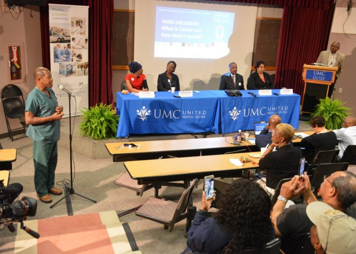 """From left: Dr. Lori Wilson, chief of surgical oncology at Howard University; cancer biologist Jasmaine McClain; Dr. Robert DeWitty Jr., surgical oncologist; and Dr. LeeAnn Bailey of the Center to Reduce Health Disparities participate in a panel discussion during the Sibley Oncology Clinic at United Medical Center's """"Cancer Awareness Day"""" in southeast D.C. on May 20, 2017. (Roy Lewis/The Washington Informer)"""