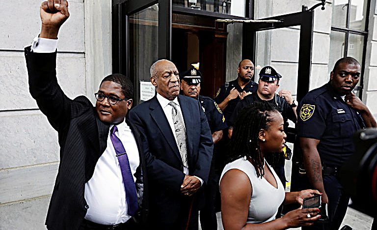 Bill Cosby (center) stands with his spokesman Andrew Wyatt (left) outside of the Montgomery County Courthouse in Norristown, Pennsylvania, on June 17, after the judge in Cosby's sexual assault case declared a mistrial. (Lucas Jackson/Reuters, Pool)