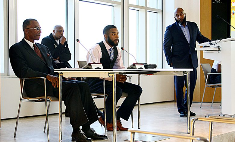 """Ivan Cloyd (center), 26, speaks on his experience as an 18-year-old father and the changes he's made over the years to better himself and his family. Cloyd was one of the panelists for the """"Voices from the Future"""" Youth Town Hall meeting in northwest D.C. on June 15. (E Watson/EDI)"""